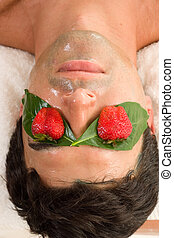 Fruit Acid Mask - A man enjoys a fruit acid peel