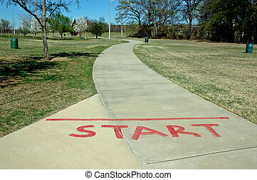 Starting Line - A starting line for a walking path at a...