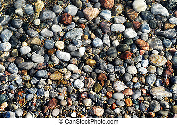 Pebbles under water - Colorful pebbles in the shallow...