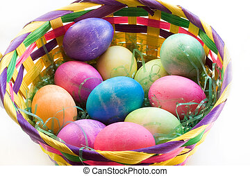 A Dozen Easter Eggs in an Easter Basket - A Dozen colored...