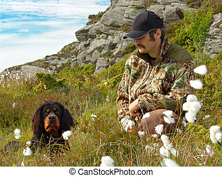 Hunter and Dog - A hunter and his Gordon Setter bird dog in...