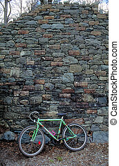 Bicycle against wall - Bicycle leaning against Stone wall