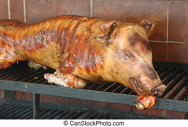 roast pig on the grill
