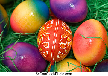 easter eggs - several colored easter eggs laying on the...