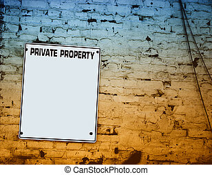 private property plate on brick wall Blue and Yellow