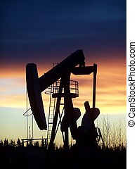 Pumpjack at sunrise - pumpjack in morning