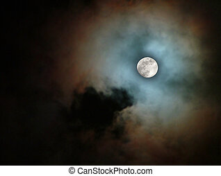 spectacular moon - moon between colorful clouds