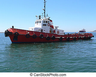 Tugboat awaiting tanker for towage operation