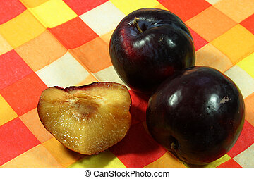 Plums on cross-hatched cloth