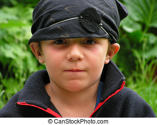 Black pirate - A young boy with a pirate outfit in the park...