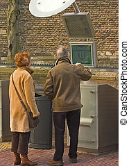 Couple getting information - An elderly couple at a...