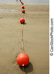 Buoys - Orange Buoys at low tide