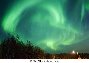 Round aurora over townlights - Round aurora borealis over...