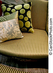 Green sofa and cushions - home interiors