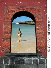 Portal to Paradise - Brick window and Girl on Beach