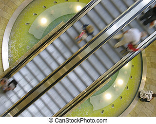 movement - persons on an escalator