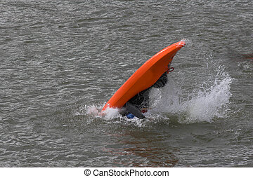 out of control - lone kayaker practicing recovery from roll...