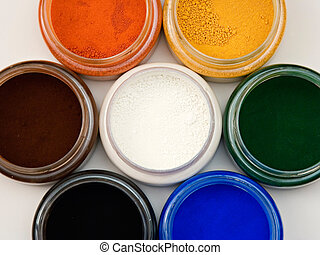 Powder pigments - Top view of natural earth pigments pots