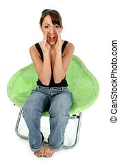 Teen Girl Yelling - Beautiful young woman sitting in green...