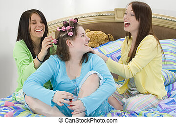 Teen Beauty Party - Three happy teen girls at slumber party...