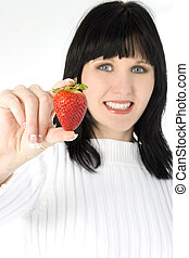 Fresh Strawberry - Beautiful young woman holding fresh...