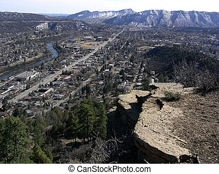 Long Way Down - View of mountain town from cliff high above