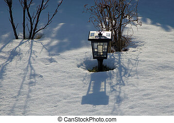 snow surrounded - garden lamp surrounded by snow