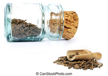 Herbal Medicine - Old glass jar with herbal medicine and...