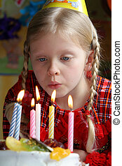 Happy birthday  - Little girl blowing birthday candles