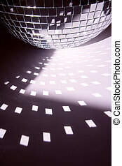 glitterball - a glitterball reflecting bright shapes on the...