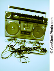 tape spewing boombox - cassette tape spewing out of a retro...