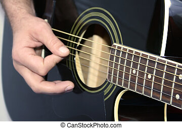 Guitar lesson - Man strumming guitar