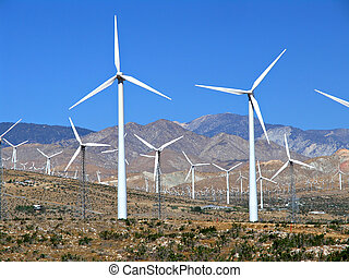 electric wind turbine field - a field of wind turbines near...