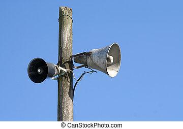 old loudspeakers on the mast