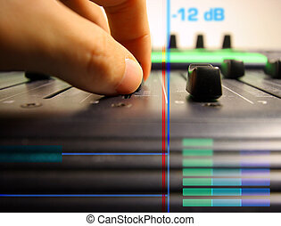 hand controlling faders - close-up of hand controlling...