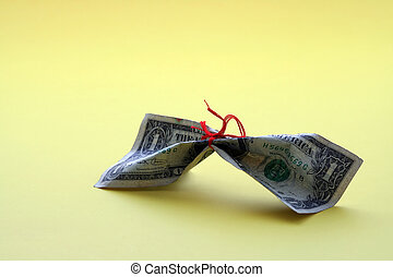 Save money - Money tied with a thread, symbolizes tight...