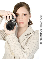 Young Photographer - Beautiful young woman with red hair and...