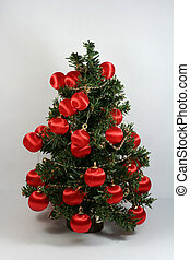 Christmas Tree - Christmas tree with red decorations on...