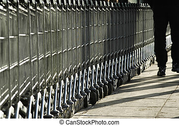 Shopping Carts - A line of multiple shopping carts.