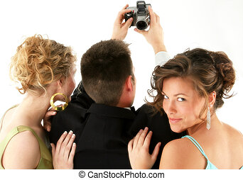 Date Night - Man and two beautiful woman taking photo with...