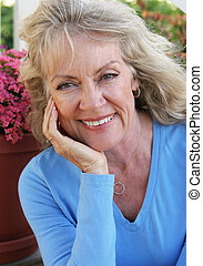Mature Beauty - Happy - A portrait of a beautiful mature...