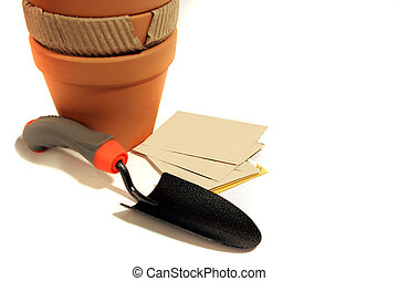 potting seeds trowel - a garden trowel and terracotta pots...