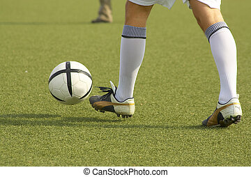Soccer - Player´s legs with a ball Player?s legs with a...