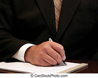 taking notes - businessman taking notes on paper with a...