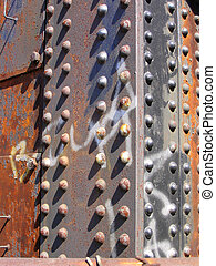 rivets background - closeup of rivets on a rusty girder