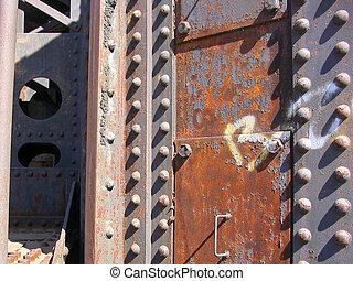 rusty girder - close up of the rusty girder of a train...