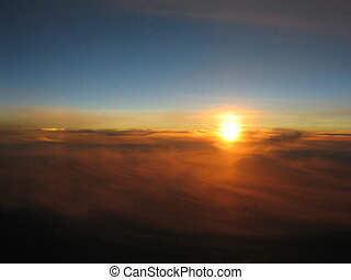 sunset above clouds - Am sunset seen from above a huge...