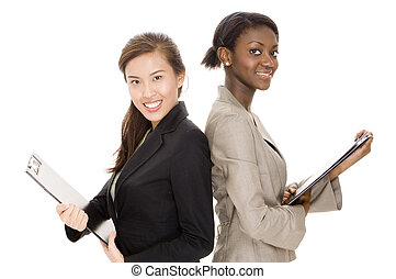 Businesswomen - Two attractive young business women with...