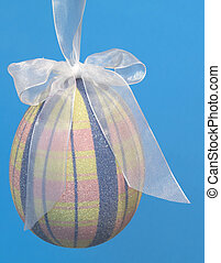 Easter egg hanging - Decorative Easter egg hanging by a...