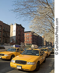 Taxis - This is a shot of some New York city taxis on a busy...